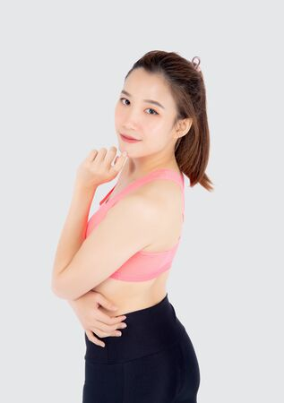 Beautiful portrait young asian woman in sport clothes with satisfied and confident isolated on white