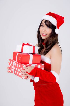 Beautiful portrait young asian woman happy holding lot of gift box with excited in xmas holiday isolated on white