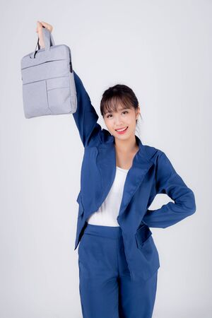 Beautiful portrait young business asian woman holding a briefcase portfolio isolated on white Standard-Bild - 131299384