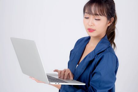 Beautiful portrait young asian business woman holding laptop computer isolated on white background, businesswoman using notebook, asia freelance girl work job surfing internet online or sending email.