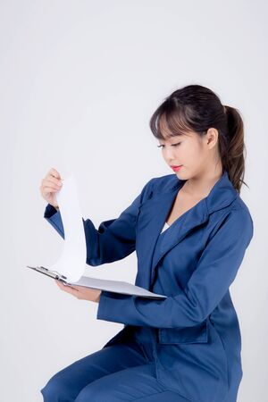 Beautiful portrait young business asian woman thinking and writing on clipboard for success isolated on white background, confident businesswoman planning and idea for inspiration and successful.