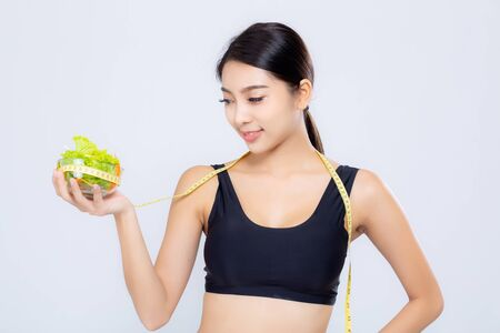 Portrait asian woman smiling holding and with measuring green apple fruit and beautiful body diet with fit isolated on white background, girl weight slim with cellulite, health and wellness concept.