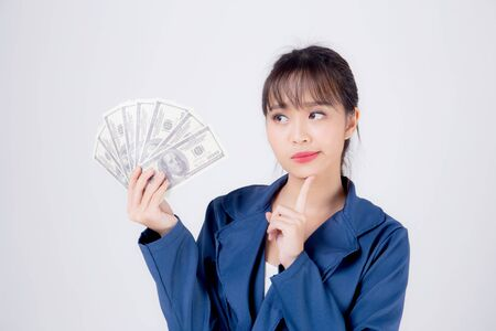 Beautiful young business asian woman holding money isolated on white background, businesswoman thinking idea planning and showing banknotes, happy girl income with profit finance and success concept.