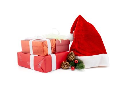 A lot of gift box with pine and pinecone and hat in season Christmas and new year isolated on white background, group of present for birthday or anniversary with surprise for happy, holiday concept. Stock Photo