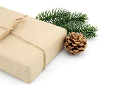Craft gift box with pine and pinecone in season Christmas and new year isolated on white background, group of present for birthday or anniversary with surprise in package for happy, holiday concept. Stock Photo