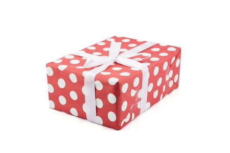 Red gift box and white ribbon in season Christmas and new year isolated on white background, luxury present for birthday or anniversary with surprise in package for happy, holiday concept. Stock Photo