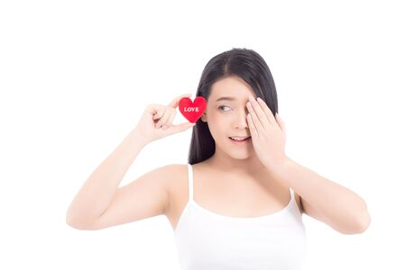Portrait of beautiful asian young woman holding red heart shape pillow and smile isolated on white background, valentines day, holiday concept. Archivio Fotografico - 133670312