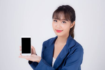 Beautiful portrait young business asian woman show blank smart mobile phone isolated on white background, businesswoman presenting smartphone for advertising, girl holding phone, communication concept. Archivio Fotografico - 133663740