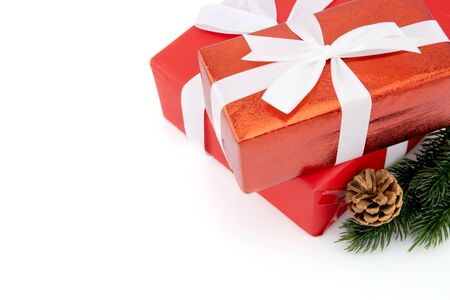 Red gift box with pine and pinecone in season Christmas and new year isolated on white background, group of present for birthday or anniversary with surprise in package for happy, holiday concept.