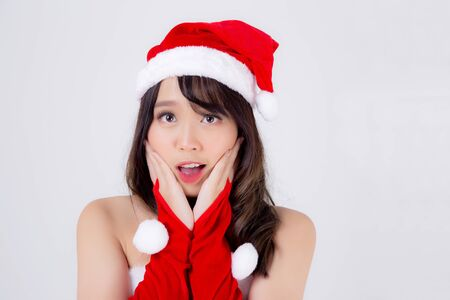 Beautiful portrait young asian woman Santa costume wear hat surprise and excited in holiday xmas, beauty model asia girl cheerful and happiness celebrating in Christmas isolated on white background. Archivio Fotografico - 133663772
