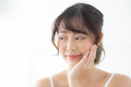 Portrait of beautiful young asian woman smile while wake up healthy and wellness with sunrise at morning in the bedroom, asia girl skin care with happy with fresh, lifestyle and relax concept. Archivio Fotografico - 133663777