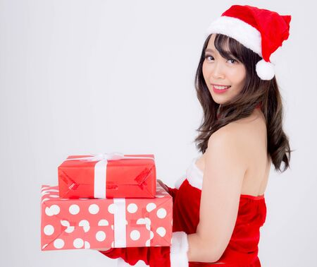 Beautiful portrait young asian woman happy holding lot of gift box with excited in xmas holiday isolated on white background, asia girl surprise and celebrating in festive Christmas and new year. Archivio Fotografico - 133663780