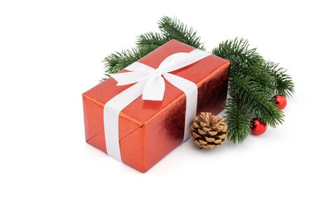 Red gift box with pine and pinecone in season Christmas and new year isolated on white background, group of present for birthday or anniversary with surprise in package for happy, holiday concept. Archivio Fotografico - 133679304