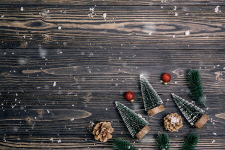 Christmas holiday composition decoration on wooden background, new year and xmas or anniversary with presents on wood table in season, top view or flat lay. Archivio Fotografico - 133679306