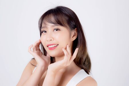Beautiful woman asian makeup of cosmetic, beauty asia girl hand touch cheek and smile attractive, face of beauty perfect with wellness isolated on white background with skin healthcare concept. Archivio Fotografico - 133670331
