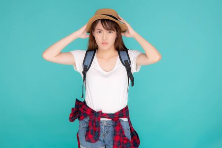 Beautiful young asian woman upset and worry travel summer trip in abroad isolated on blue background, tourist asian girl having problem and stress journey in vacation for leisure, holiday concept. Standard-Bild - 134078906
