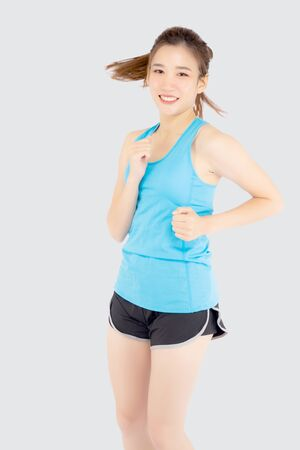 Beautiful young asian woman happy and smiling jogging isolated on white background, asia girl cheerful in sport is activity exercise cardio and workout with running for healthy, health concept.