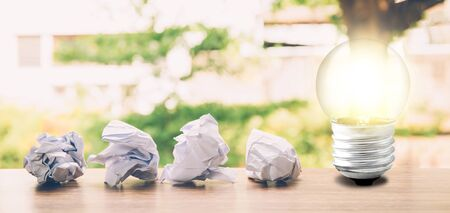 Idea and inspiration concept with paper crumple and light bulb about success 版權商用圖片