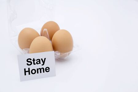 Easter egg with text stay home isolated on white Reklamní fotografie