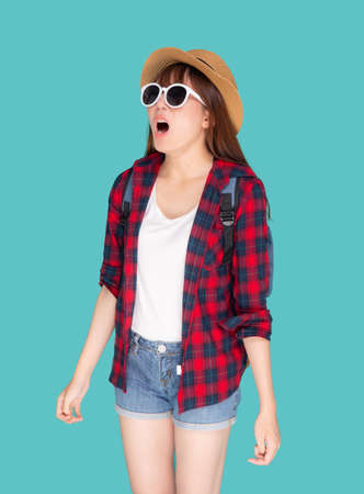 Beautiful young asian woman shouting sound loud with mouth for announce something in vacation travel with excited isolated on blue background, tourist asia girl journey in summer concept. Stok Fotoğraf