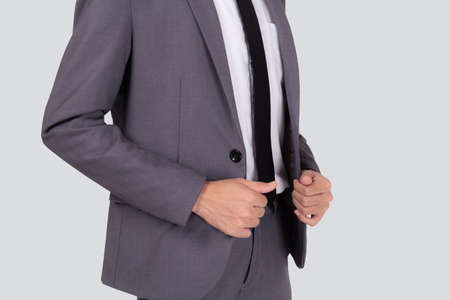 Closeup young asian businessman in suit with confident and friendly isolated on white background, business man smart with success, manager or executive with handsome and leadership. Stok Fotoğraf