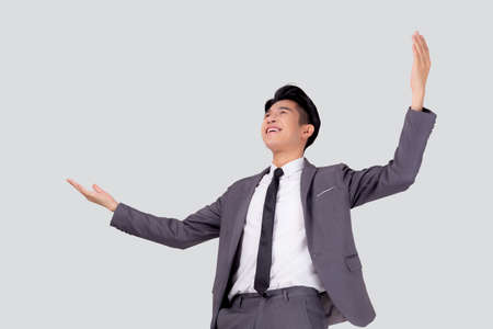 Portrait businessman in suit standing with win success isolated on white background, young asian business man is manager or executive having confident and excited is positive, expression and emotion.