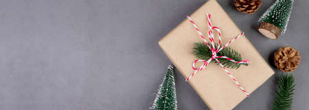 Christmas holiday composition with gift box decoration, new year and xmas or anniversary with presents on cement floor background in season, top view or flat lay, copy space, banner website. Stok Fotoğraf