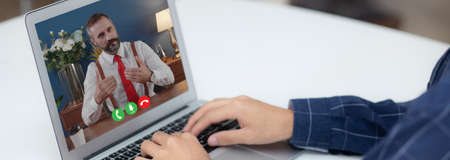 Young asian businessman video conference and discussion, man work from home with laptop computer with social distancing, meeting online, communication and business concept, banner website.