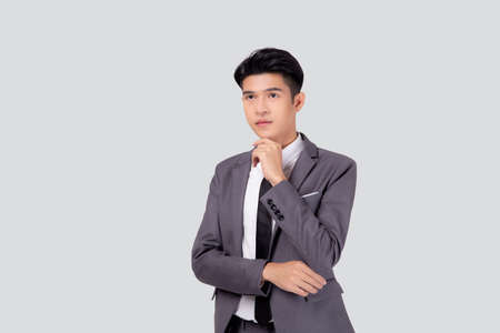Portrait young asian business man in suit with smart thinking idea isolated on white background, businessman standing and planning for success, handsome manager or executive, emotion and expression.
