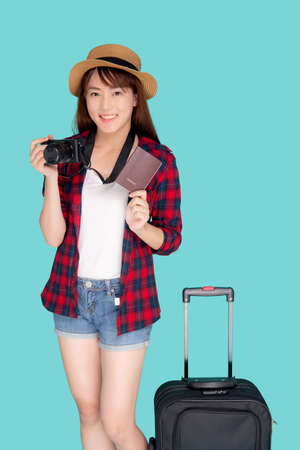 Beautiful portrait young asian woman with luggage smiling and travel summer trip for abroad in vacation, happy asia girl holding camera and passport with suitcase for journey with cheerful in holiday.