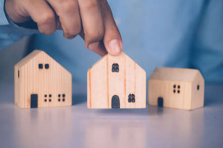 Insurance house for security and care, choice real estate, costs and loan and mortgage, protection of home and advisor with investment in residential, assurance of property, business concept.