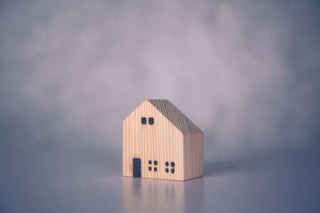 Mini wooden home model concept, investment of real estate and asset, tax of property and rental for finance, no people, small house and inspiration, mortgage and loan for residence, business concept. Stok Fotoğraf