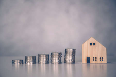 Stack of coin with revenue and saving money for real estate and success, finance and investment, insurance home, deposit and property and financial, residential and refinance, business concept.