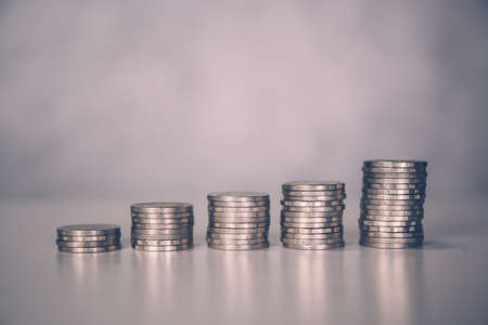Coin stack with increase growth, finance and saving, investment for profit and success, planning with financial, growing economy and fund, stock and income, loan and insurance, business concept.