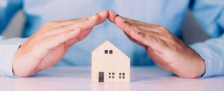 Insurance house for security and care, real estate, costs and loan and mortgage, protection of home and advisor with investment in residential, assurance of property for finance, business concept. Stok Fotoğraf