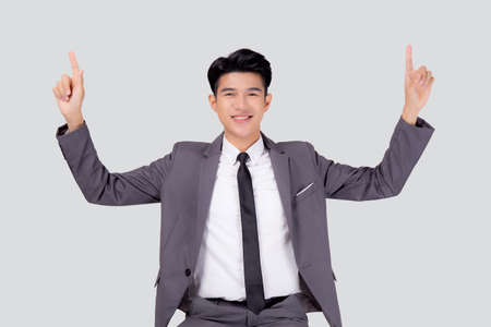 Portrait young asian business man pointing and presenting isolated on white background, advertising and marketing, executive and manager, male confident showing success, expression and emotion.