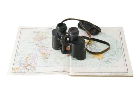 old commanders binoculars with a map