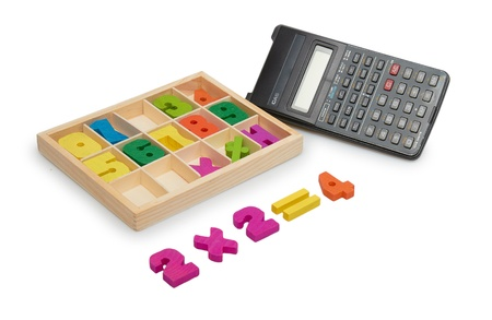 Wooden numbers with a calculator photo