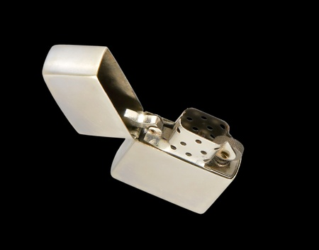 Metallic lighter isolated on a white background. photo