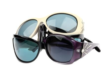 Many sunglasses isolated on a white background Stock Photo