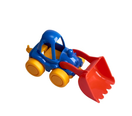 Small toy tractor isolated on a white background photo