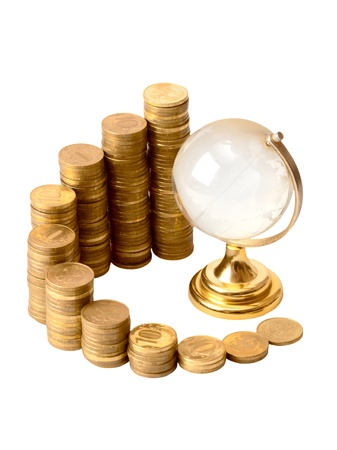 Gold coins and crystal globe isolated on a white background photo
