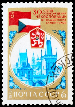 fascist: USSR - CIRCA 1975: A stamp printed USSR shows image thirtieth anniversary of Czechoslovakias liberation from fascist invaders, circa 1975
