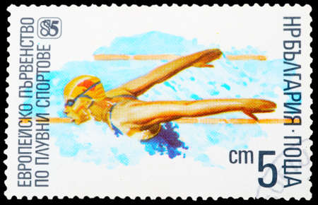 BULGARIA - CIRCA 1985: A stamp printed in Bulgaria, for the European Championships in swimming, showing a swimming athlete, circa 1985. photo