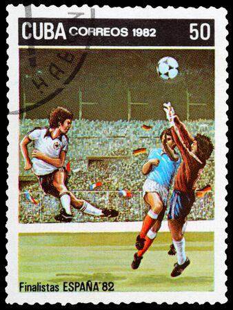 CUBA - CIRCA 1982: a stamp printed by CUBA shows football players. World football cup in Espania, circa 1982 photo