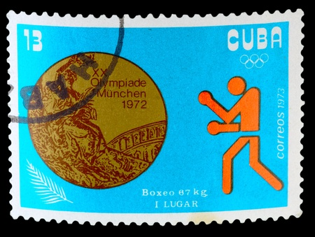 knockdown: CUBA - CIRCA 1973: A stamp printed by Cuba, shows medals Won by Cubans at the 1973 Summer Olympics, Munich, circa 1973. Editorial