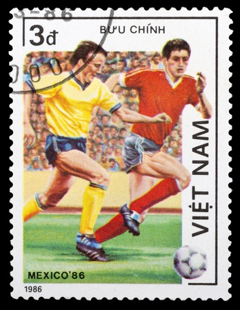 VIETNAM - CIRCA 1986: a stamp printed by VIETNAM shows football players. World football cup in Mexico, circa 1986 Editorial