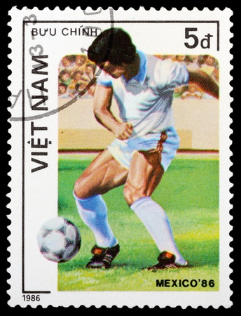 VIETNAM - CIRCA 1986: a stamp printed by VIETNAM shows football players. World football cup in Mexico, circa 1986 photo