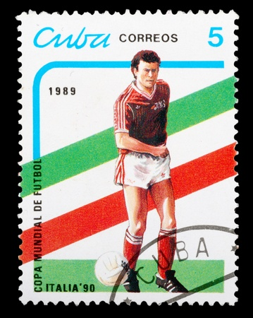 CUBA - CIRCA 1989: a stamp printed by CUBA shows football players. World football cup in Italy, series, circa 1989 photo