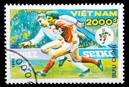 VIETNAM - CIRCA 1990: a stamp printed by Vietnam shows football players. World football cup in Italy, series, circa 1990 photo